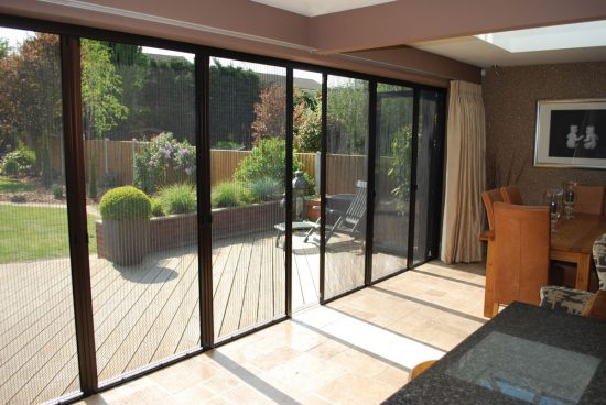 Bi-fold-patio-doors-with-screens-look-great-and-save-from-too-intense-sunshine